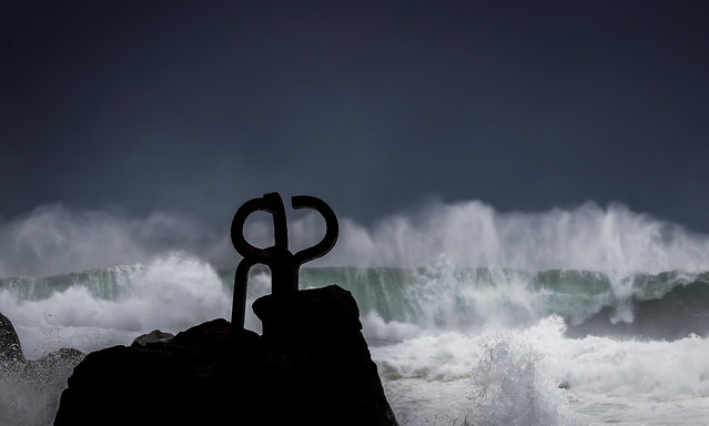 "Waves hit against Eduargo Chillida's sculpture ""Peine del Viento"" (""The Wind's Comb"") at the Cantabrian coast in San Sebastian city, northern Spain, 26 October 2020. Spain's State Agency of Meteorology (Aemet) forecasts abundant rain and storms in the Bay of Biscay and strong winds for 26 October, also in the eastern Andalusian coast, while temperatures will fall in much of the country, notably in the eastern half of the peninsula, and in the Balearic Islands. (Photo by Javier Etxezarreta/EPA/EFE)"