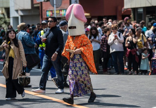 A man wear a phallic-shaped hat during Kanamara Matsuri (Festival of the Steel Phallus) on April 1, 2018 in Kawasaki, Japan. The Kanamara Festival is held annually on the first Sunday of April. The pen*s is the central theme of the festival, focused at the local pen*s-venerating shrine which was once frequented by prostitutes who came to pray for business prosperity and protection against sexually transmitted diseases. Today the festival has become a popular tourist attraction and is used to raise money for HIV awareness and research. (Photo by Carl Court/Getty Images)
