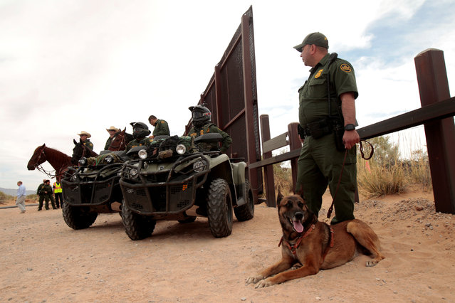 Border Patrol agents keep watch during the official start for the construction of new bollard wall to replace 20-miles of primary vehicle barriers in Santa Teresa, New Mexico, United States April 9, 2018. (Photo by Jose Luis Gonzalez/Reuters)