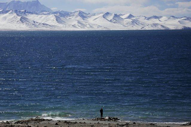 A Tibetan man stands at shores of Namtso lake in the Tibet Autonomous Region, China November 18, 2015. (Photo by Damir Sagolj/Reuters)