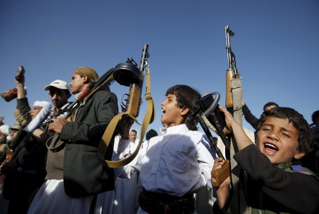Boys hold up rifles as they participate in a demonstration against Saudi-led strikes in Yemen's capital Sanaa November 20, 2015. (Photo by Khaled Abdullah/Reuters)