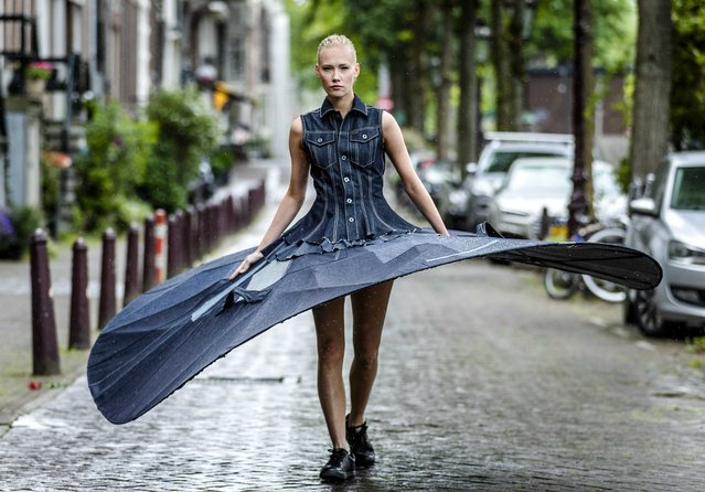Ballerina Kira Hilli of the Netherlands National Ballet dances in a tutu with a diameter of 3 meters for a video made for the 1.5 meter society, on the Prinsengracht in Amsterdam, The Netherlands, 04 June 2020 (issued on 12 June 2020). The so-called social distance tutu is made of denim fabric, specially made for the Safe Distance Ballet. (Photo by Remko de Waal/EPA/EFE)