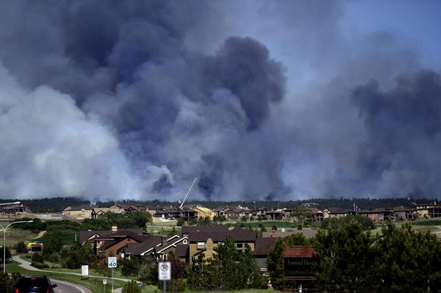 Large plumes of smoke rise from a wild land fire in the Black Forest northeast of Colorado Springs, Colo. on Tuesday, June 11, 2013.  Homes have already burned and the wind is expected to continue through the afternoon. (Photo by Aaron Ontiveroz/AP Photo/The Denver Post)