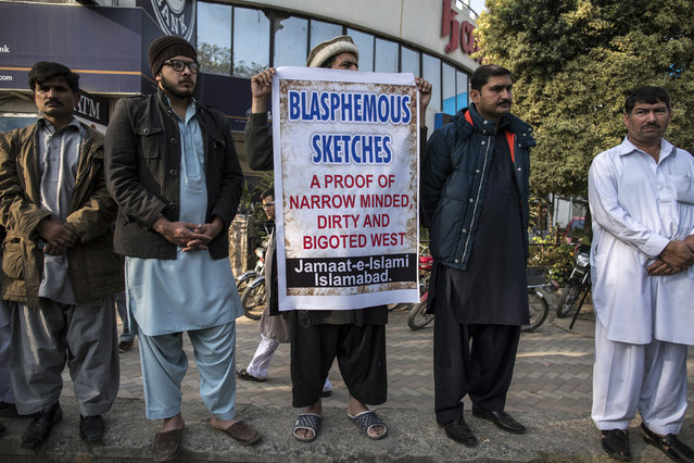 Supporters of the Islamic political party Jamaat-e-Islami hold placards as they listen to a speech during a protest against satirical French weekly Charlie Hebdo, in Islamabad January 16, 2015. (Photo by Zohra Bensemra/Reuters)