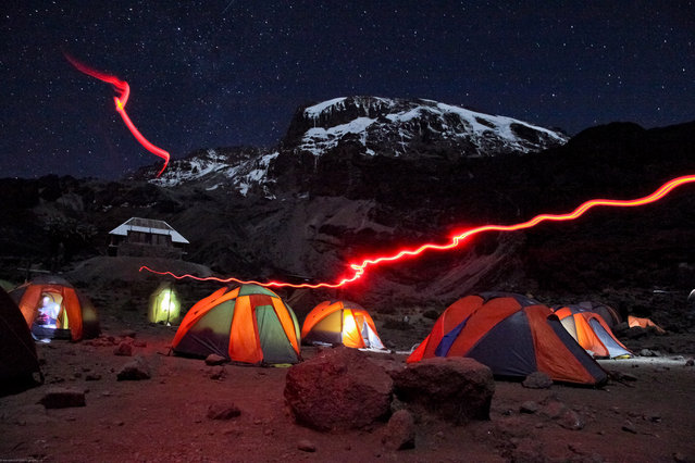 """Barranco Camp at night, Kilimanjaro"". Barranco camp was our third on our 7 day hike to the summit of Mount Kilimanjaro. Taken after dinner while the group was getting ready to get a good nights rest before tackling infamous Barracno Wall in the morning. Location: Mount Kilimanjaro, Tanzania. (Photo and caption by Trevor Booth/National Geographic Traveler Photo Contest)"
