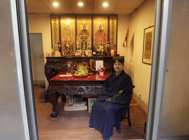 Lu Wei-ming, priest of the Wei-ming temple, poses in front of an altar in New Taipei city January 8, 2015. (Photo by Pichi Chuang/Reuters)