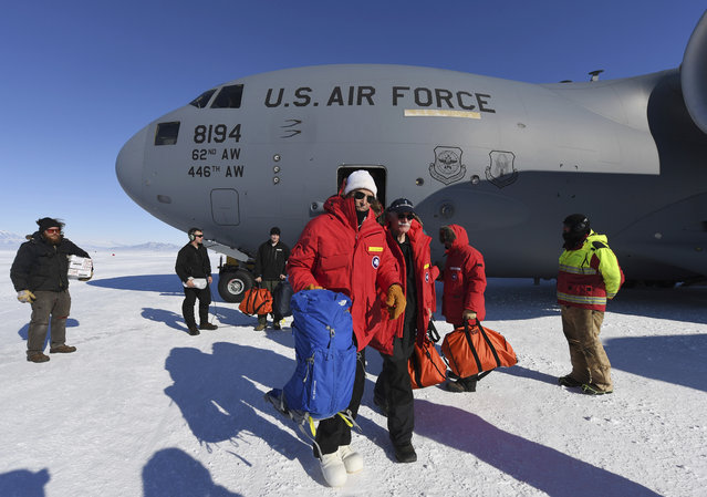 U.S. Secretary of State John Kerry, center, disembarks from a U.S. Air Force C17 Globemaster with the National Science Foundation's Scott Borg, right, at the Pegasus ice runway near McMurdo Station, Antarctica on Friday, November 11, 2016. (Photo by Mark Ralston/Pool Photo via AP Photo)
