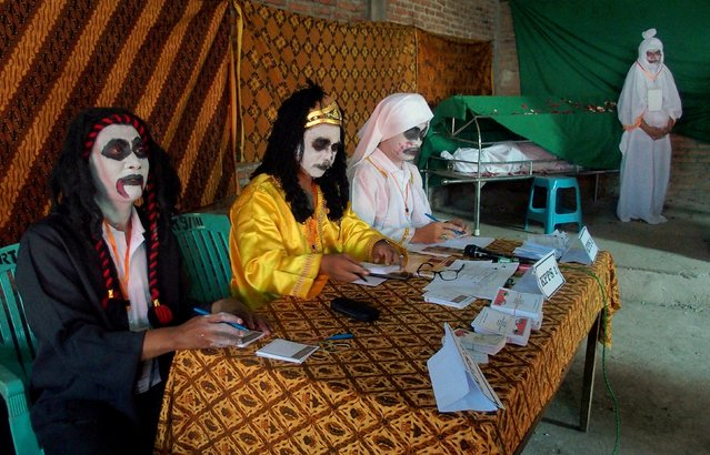 Election officials dress as ghosts at a polling station for local elections in Randusari village, Semarang, Central Java, Indonesia June 27, 2018 in this photo taken by Antara Foto. (Photo by R. Rekotomo/Reuters/Antara Foto)