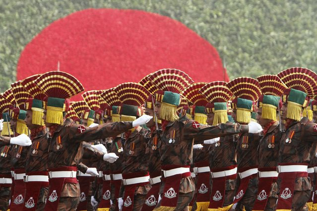 Members of the Bangladesh's border guards march past a dais during the celebration of the country's 45th Victory Day at the national parade ground in Dhaka December 16, 2015. (Photo by Ashikur Rahman/Reuters)
