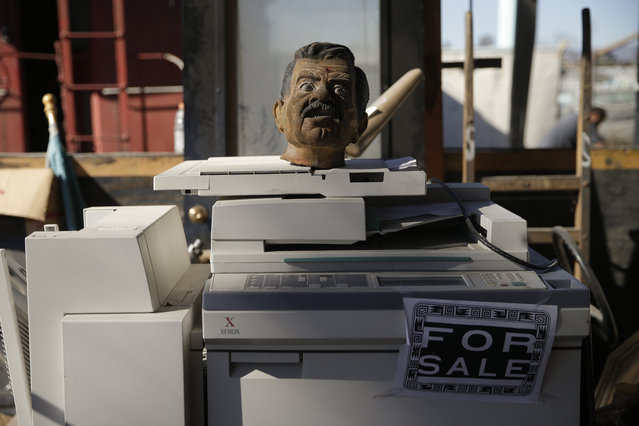 In this Wednesday, November 11, 2015 photo, a bust sits on a copy machine at Aadlen Brothers Auto Wrecking, also known as U Pick Parts, in the Sun Valley section of Los Angeles. (Photo by Jae C. Hong/AP Photo)