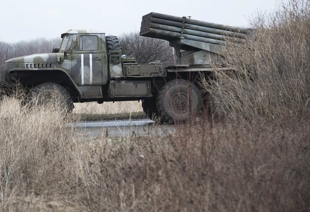 A multiple rocket launcher system of the Ukrainian armed forces is seen behind bushes on the outskirts of Artemivsk, Donetsk region, February 4, 2015. (Photo by Sergey Polezhaka/Reuters)