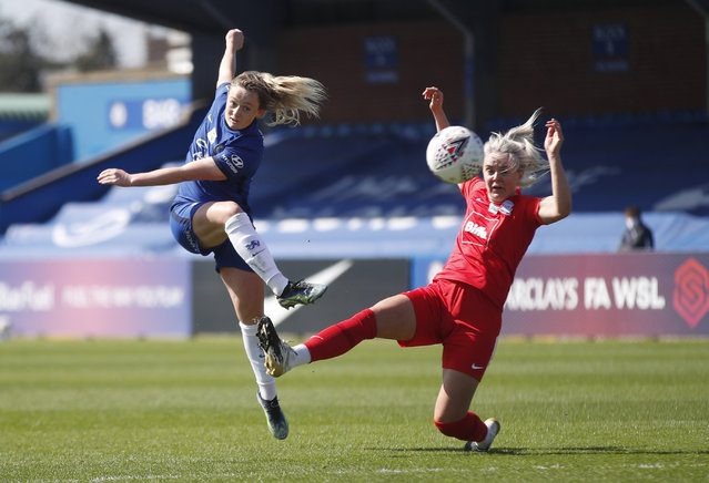 Chelsea's Erin Cuthbert in action with Birmingham City's Mollie Green  during the FA Women's Super League match at Kingsmeadow Stadium in London, United Kingdom on April 4, 2021. (Photo by Matthew Childs/Action Images via Reuters)