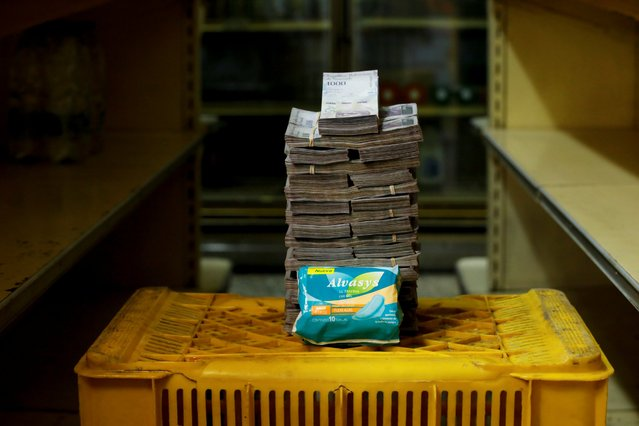 A package of pads is pictured next to 3,500,000 bolivars, its price and the equivalent of 0.53 USD, at a mini-market in Caracas, Venezuela August 16, 2018. It was the going price at an informal market in the low-income neighborhood of Catia. (Photo by Carlos Garcia Rawlins/Reuters)