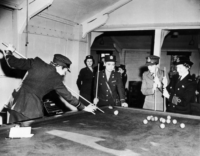 Members of the British and American womens services gather around pool table in the recreation hall at Allied Headquarters in England, May 24, 1944. The British women joined in the ceremonies celebrating the second anniversary of the U.S. Womens Army Corps. Left to right are: Air Commandant Lady Welsh; Lieutenant Colonel Anna W. Wilson, of the WAC, from Studio City, Calif.; Major General Whately, director of the ATS; and Deputy Director Goodenough, of the Wrens. (Photo by AP Photo)