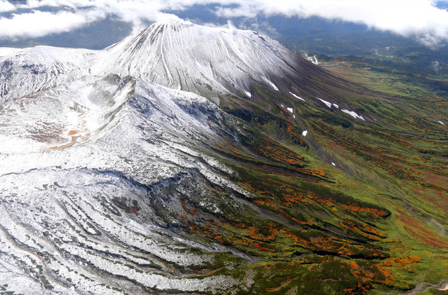 In this aerial image, Asahidake Mountain of the Daizetsuzan Volcanic Group is covered with the first snow of the season on September 19, 2013 in Higashikawa, Hokkaido, Japan. The first snow has fallen 25 days earlier than last year.  (Photo by The Asahi Shimbun via Getty Images)