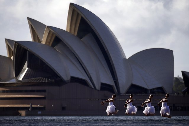 Ballerinas from The Australian Ballet perform on a floating platform, during a promotional event in front of the Sydney Opera House, February 18, 2015. (Photo by David Gray/Reuters)