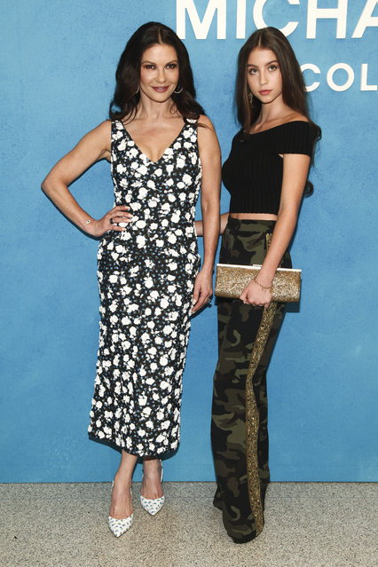 Catherine Zeta-Jones, left, and Carys Zeta Douglas, right, attend the NYFW Spring/Summer 2019 Michael Kors fashion show at Pier 17 on Wednesday, September 12, 2018, in New York. (Photo by Andy Kropa/Invision/AP Photo)
