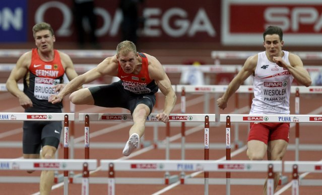 Arthur Abele of Germany clears a hurdle in front of Mathias Brugger of Germany (L) and Pawel Wiesiolek of Poland in their men's heptathlon 60 metres hurdles event during the IAAF European Indoor Championships in Prague March 8, 2015. REUTERS/David W Cerny (CZECH REPUBLIC  - Tags: SPORT ATHLETICS)
