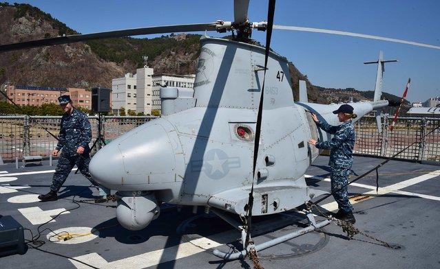 Crew members of the USS Fort Worth (LCS 3) check a MQ-8B Fire Scout Unmanned Aerial System, during a media tour on board, at a naval port in Busan March 14, 2015. USS Fort Worth is the first US Navy Littoral Combat Ship to visit South Korea and is participating in the annual Foal Eagle exercise with the Republic of Korea navy. (Photo by Jung Yeon-Je/Reuters)