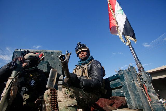Iraqi rapid response forces ride in a military vehicle during a fight with Islamic State militants in Intisar district of eastern Mosul, Iraq, December 22, 2016. (Photo by Khalid al Mousily/Reuters)