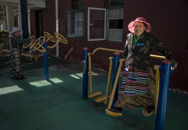 An elderly Tibetan woman exercises at the Caigongtang Nursing Home during a government organized visit for journalists on June 3, 2021 in Lhasa, Tibet Autonomous Region, China. (Photo by Kevin Frayer/Getty Images)