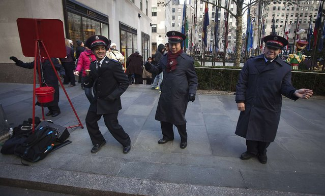 Salvation Army members sing and dance at Rockefeller Center during Black Friday Sales in New York November 29, 2013. Black Friday, the day following Thanksgiving Day holiday, has traditionally been the busiest shopping day in the United States. (Photo by Carlo Allegri/Reuters)