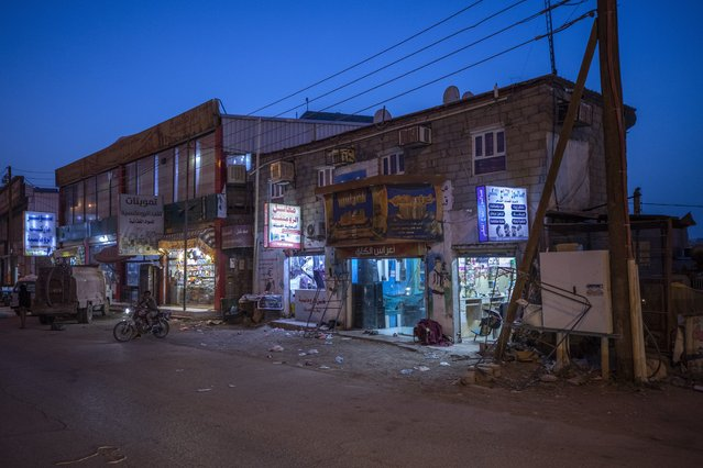 Shops are open for business in Marib, Yemen, Monday, June 21, 2021. (Photo by Nariman El-Mofty/AP Photo)