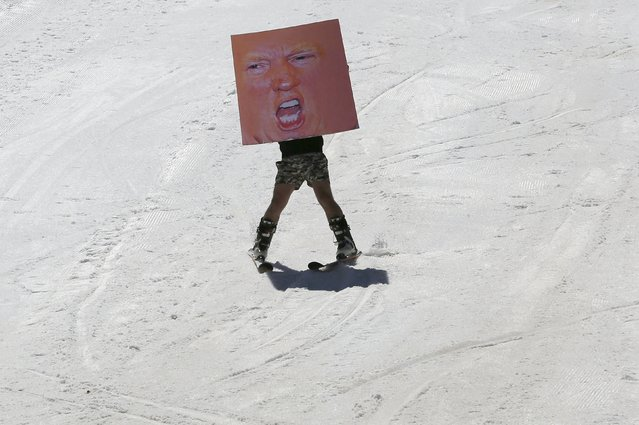 A man participates in the Red Bull Jump & Freeze Lebanon, with a poster of U.S Republican presidential candidate Donald Trump, at Mzaar Kfardebian Ski Resort in mount Lebanon February 28, 2016. (Photo by Jamal Saidi/Reuters)