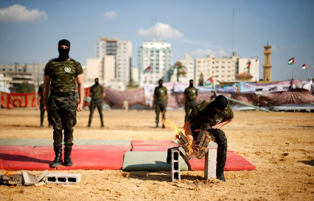 Members of Palestinian National Security Forces loyal to Hamas breaks burning bricks during a military graduation ceremony, in Gaza City January 22, 2017. (Photo by Suhaib Salem/Reuters)
