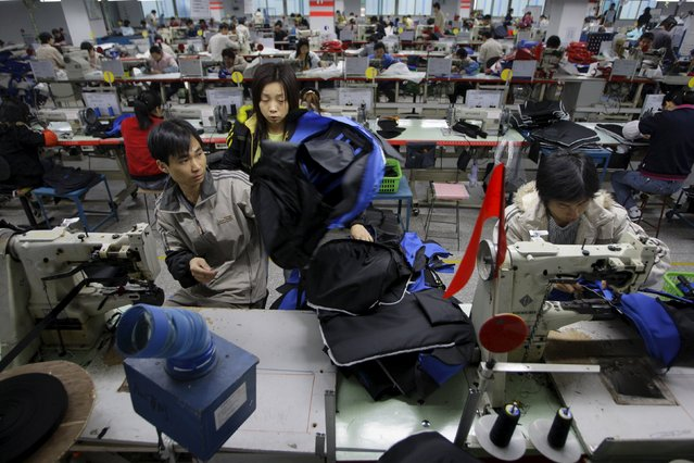People work at a bag factory in Dongguan, southern China's Guangdong province in this January 26, 2008 file picture. (Photo by Jason Lee/Reuters)