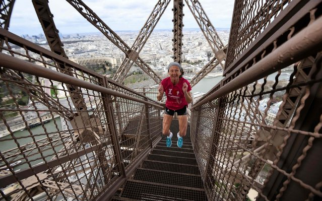 """Laure Chardin, 45, walks up stairs during a training session on March 8, 2019 at the Eiffel Tower in Paris, before the tower running event """"La Verticale de la Tour Eiffel"""" to be held on March 13. (Photo by Anne-Christine Poujoulat/AFP Photo)"""