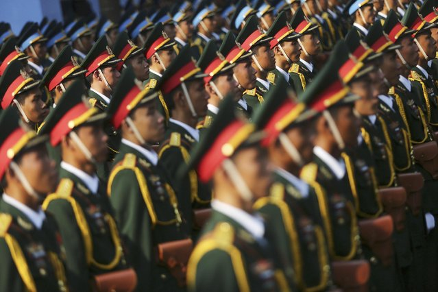 Vietnamese honor guards attend a parade celebrating the 40th anniversary of the end of the Vietnam War which is also remembered as the fall of Saigon, in Ho Chi Minh City, Vietnam, Thursday, April 30, 2015. (Photo by Na Son Nguyen/AP Photo)