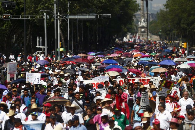 Demonstrators take part during a march for Labour Day in Mexico City May 1, 2015. (Photo by Edgard Garrido/Reuters)
