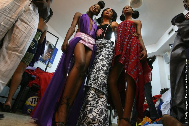 Nigerian fashion models pose for a photo behind the curtain  during their fashion show to promote ethnic fashion June 13, 2006 in Tel Aviv, Israel