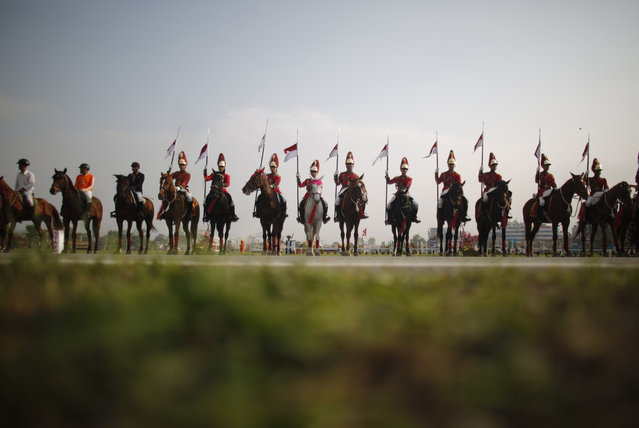 In this April 5, 2019, photo, Nepalese cavalry soldiers rehearse for the Ghode Jatra festival in Kathmandu, Nepal. (Photo by Niranjan Shrestha/AP Photo)