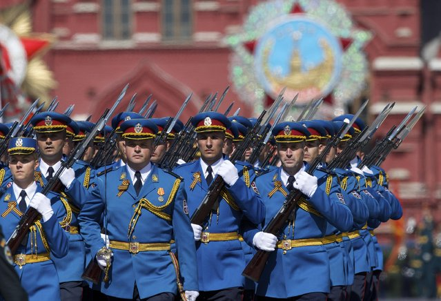 Serbian army soldiers march along the Red Square during a general rehearsal for the Victory Day military parade which will take place at Moscow's Red Square on May 9 to celebrate 70-years after the victory in WWII, in Moscow, Russia, Thursday, May 7, 2015. (Photo by Ivan Sekretarev/AP Photo)
