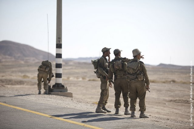 Soldiers set up a check point  60 km from Eilat, following series of coordinated gun and roadside bomb attacks against miltary and civilian targets near the Israeli - Egyptian border
