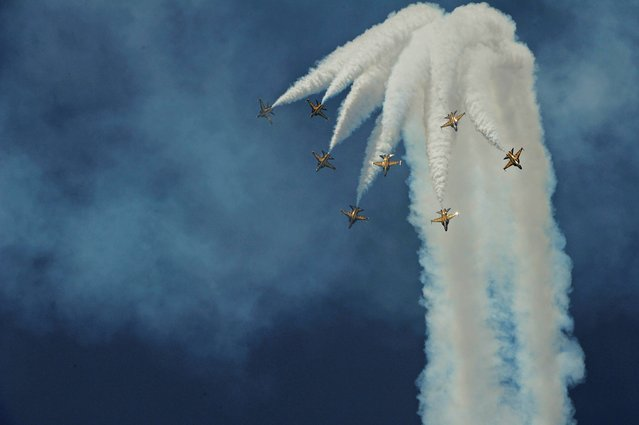 The T-50 jets of South Korean Air Force aerobatics team, the Black Eagles, perform a maneuver in the aerial display at the Singapore Air Show on Saturday, February 15, 2014. (Photo by Joseph Nair/AP Photo)