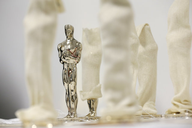 Oscar statuettes, some wrapped in cloth, wait to be inspected before being finished at the Polich Tallix Fine Art Foundry in Rock Tavern, N.Y., Thursday, January 12, 2017. (Photo by Seth Wenig/AP Photo)