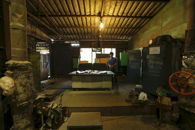 A worker stands in an office inside a sugar mill at Pakchong district in Ratchaburi province, Thailand March 22, 2016. (Photo by Jorge Silva/Reuters)