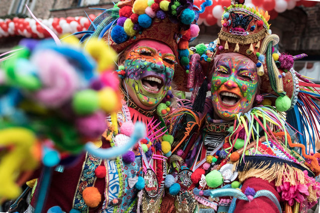 """Costumed carnival revelers celebrate Carnival in Duesseldorf, Germany, 23 February 2017. The street carnival begins on """"Fat Thursday"""" in the Rhineland and elsewhere. (Photo by Federico Gambarini/AFP Photo/DPA)"""