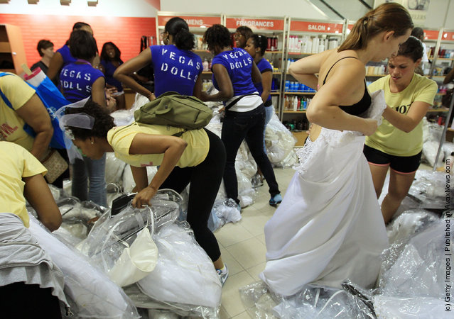 Bride to be Amanda Joyce tries on a wedding gown during Filene's Basement's annual sale