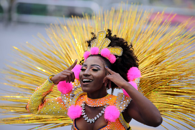 A reveller parades for the Aguia de Ouro samba school during the carnival in Sao Paulo, Brazil, February 25, 2017. (Photo by Paulo Whitaker/Reuters)