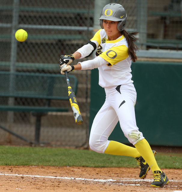 Oregon outfielder Janie Takeda hits a double to center field during the fourth inning of an NCAA softball game against North Dakota State at Howe Field, Friday, May 15, 2015 in Eugene, Ore. (Photo by Brian Davies/The Register-Guard via AP Photo)