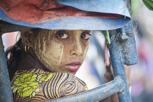 This photo taken on May 21, 2015 shows an ethnic Rohingya Muslim woman looking back as she rides a tuk tuk near a camp set up outside the city of Sittwe in Myanmar's Rakhine state. Malaysia ordered search and rescue missions on May 22 for thousands of boatpeople stranded at sea, as Myanmar hosted talks with US and Southeast Asian envoys on the migrant exodus from its shores. (Photo by Ye Aung Thu/AFP Photo)