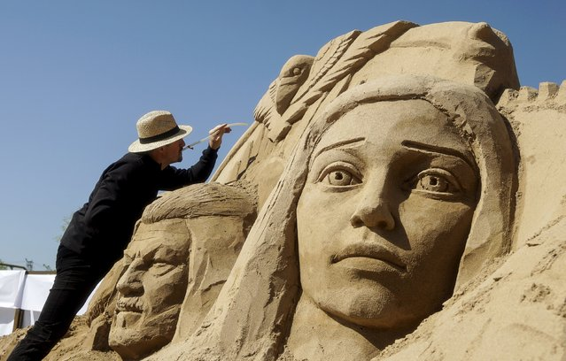 """Andrey Vazhinsky of Ukraine works on his creation during the Sand Sculpture Festival """"Sand Fantasy"""" in Almaty, Kazakhstan, April 15, 2016. (Photo by Shamil Zhumatov/Reuters)"""