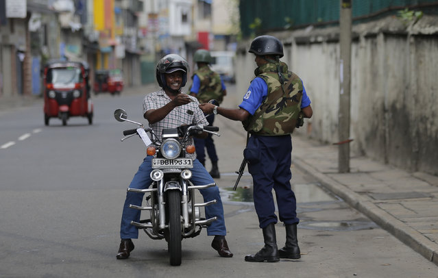 Sri Lankan naval soldiers check the identity of a motorists in Colombo, Sri Lanka, Wednesday, May 1, 2019. Sri Lanka's major political parties called off traditional May Day rallies due to security concerns following the Easter bombings that killed more than 250 people and were claimed by militants linked to the Islamic State group. (Photo by Eranga Jayawardena/AP Photo)