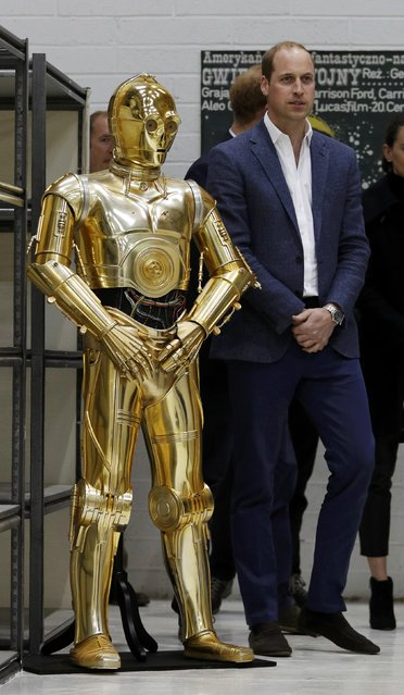 Britain Prince William looks at droid C3P0 from Star Wars as they visit the creature and droid department at Pinewood studios in Iver Heath, west of London, Britain on April 19, 2016. (Photo by Adrian Dennis/Reuters)