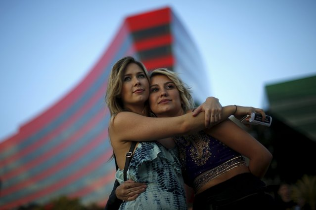 Cherilyn Wilson, 26, (L) hugs Chelsea Kane, 26, at a celebration rally in West Hollywood, California, United States, June 26, 2015. (Photo by Lucy Nicholson/Reuters)