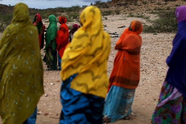 Women look on as men show aid workers the carcasses of livestock that died due to drought close to the town of Borama, Somaliland April 17, 2016. (Photo by Siegfried Modola/Reuters)